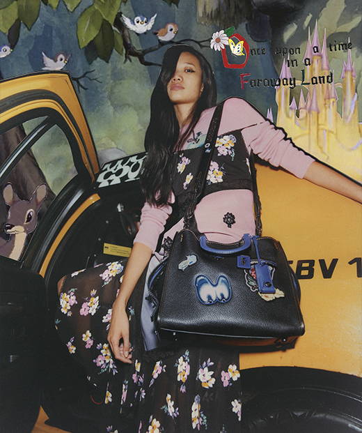 Model with Coach Rogue Bag with Patches