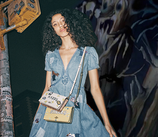 Model with Coach Crossbody Bags